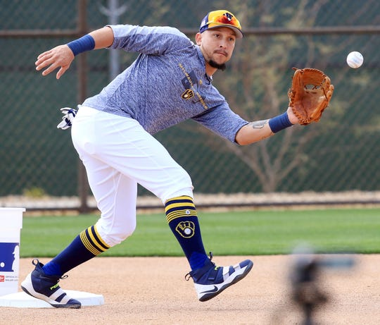 Milwaukee Brewers Hernan Perez takes throws to second base, during spring training drills, Sunday, February 17, in Phoenix, Arizona.(Photo/Roy Dabner) ORG XMIT: RD054