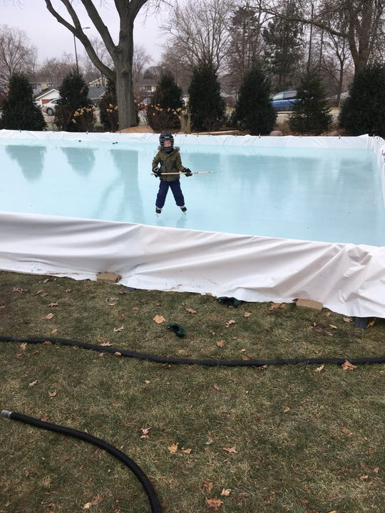 Matt Medvecz's 4 1/2-year-old son Tyson plays hockey on their backyard ice rink in Greendale.
