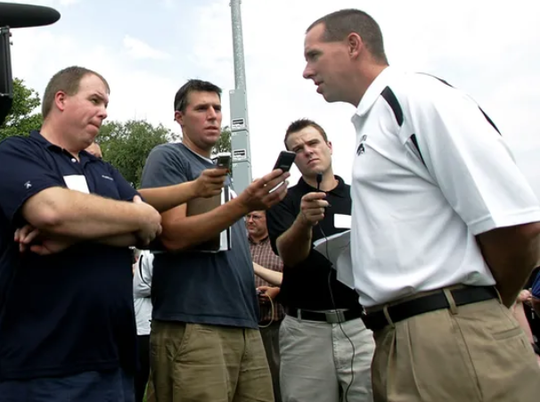 Iowa assistant coach Eric Johnson visits with reporters in a 2007 interview in Iowa City.