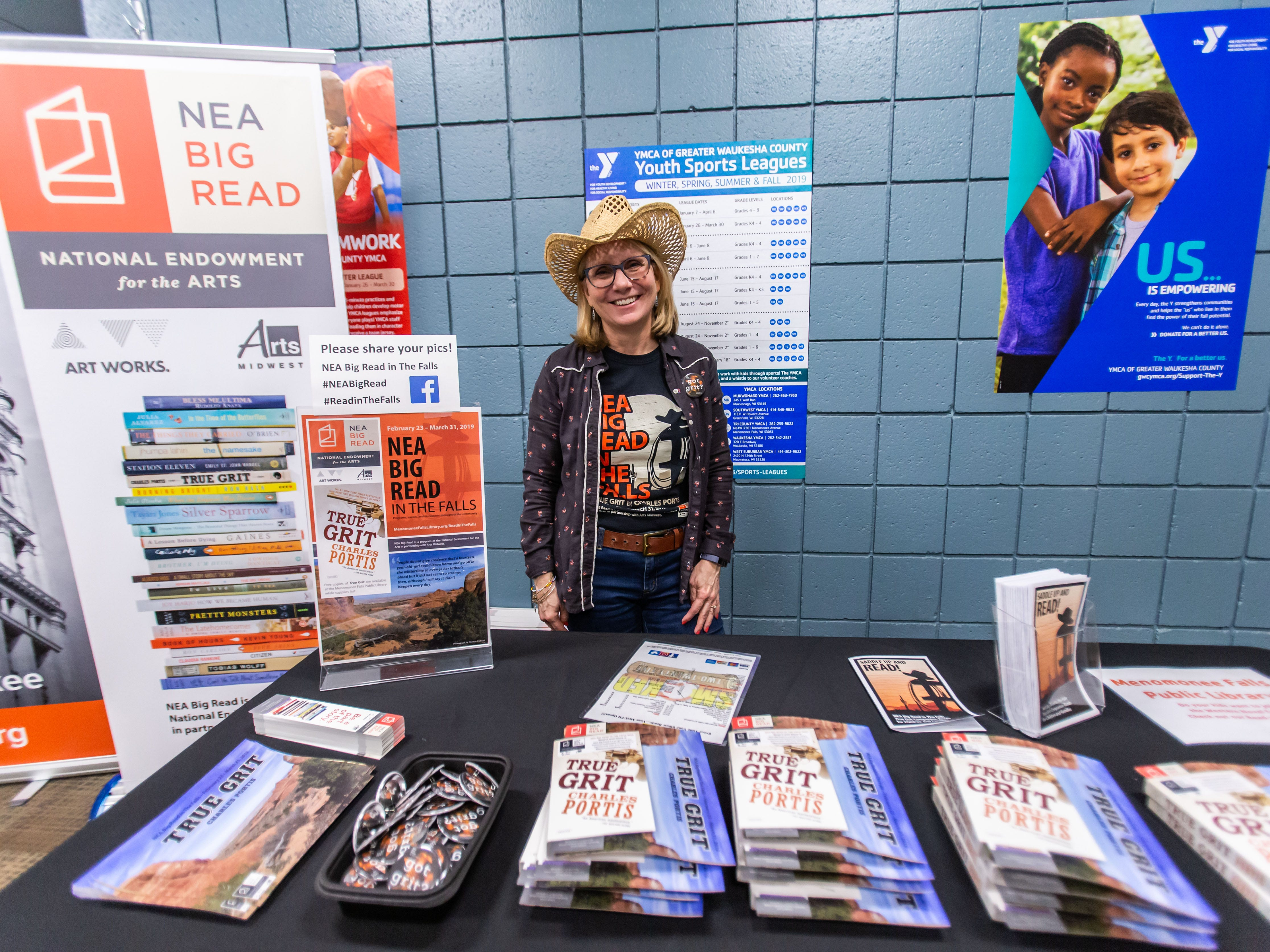 Menomonee Falls Library Director Karol Kennedy hands out free copies of the book True Grit during the Hometown Hoedown NEA Big-Read Kickoff Event at the Tri County YMCA in Menomonee Falls on Saturday, Feb. 23, 2019. The event featured live music, food, games, and western themed activities for the whole family.
