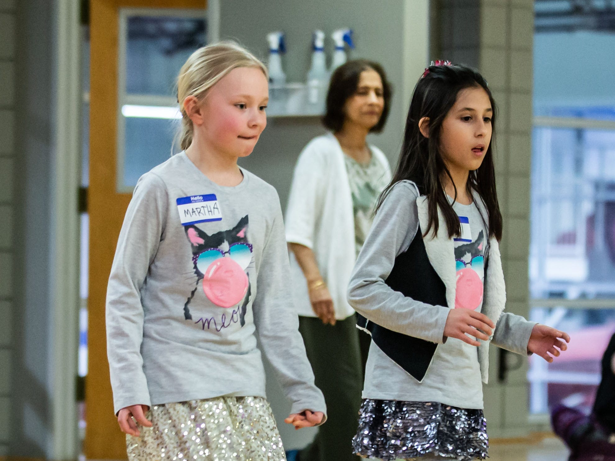 Martha Kosanke (left), 8, and Leah Cheudoir, 10, both of Menomonee Falls, try line dancing during the Hometown Hoedown NEA Big-Read Kickoff Event at the Tri County YMCA in Menomonee Falls on Saturday, Feb. 23, 2019. The event featured live music, food, games, and western themed activities for the whole family.