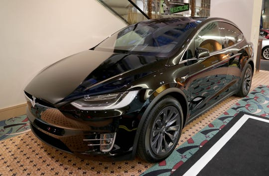 Tesla model X, which costs around $78,950, the company website says, is on display.