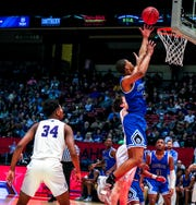 Georgiana's Martavius Payton reaches high for a rebound against Decatur Heritage during Monday's Class 1A semifinals at the Birmingham-Jefferson Civic Center.