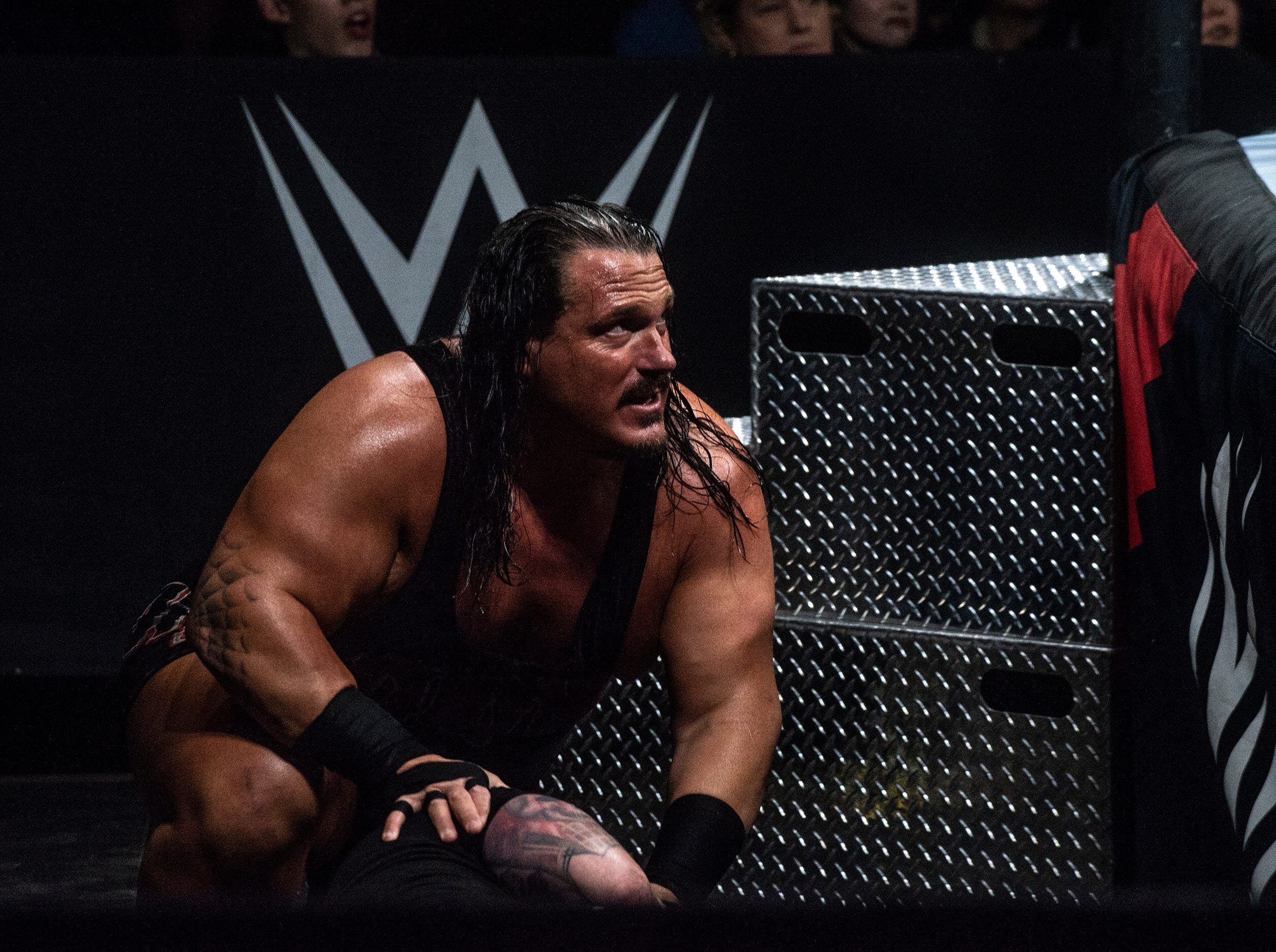 Rhyno looks on from outside the ring. The Singh Brothers and Jinder Mahal in a six man tag team match against Titus OÕNeil, Heath Slater and Rhyno. WWE Live Road to Wrestlemania came to Garrett Coliseum in Montgomery on Sunday, Feb. 24, 2019.