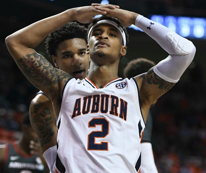Auburn forward Chuma Okeke (5) talks to guard Bryce Brown (2) after Brown fouled an Arkansas player during the first half of an NCAA college basketball game Wednesday, Feb. 20, 2019, in Auburn, Ala.
