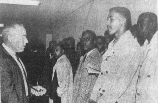 Clipping from a February 1960 Montgomery Advertiser. Sheriff Mac Sim Butler, left, speaks to Alabama State College students who were staging a sit-in at the whites-only lunch counter at the Montgomery County Courthouse on Feb. 25, 1960.