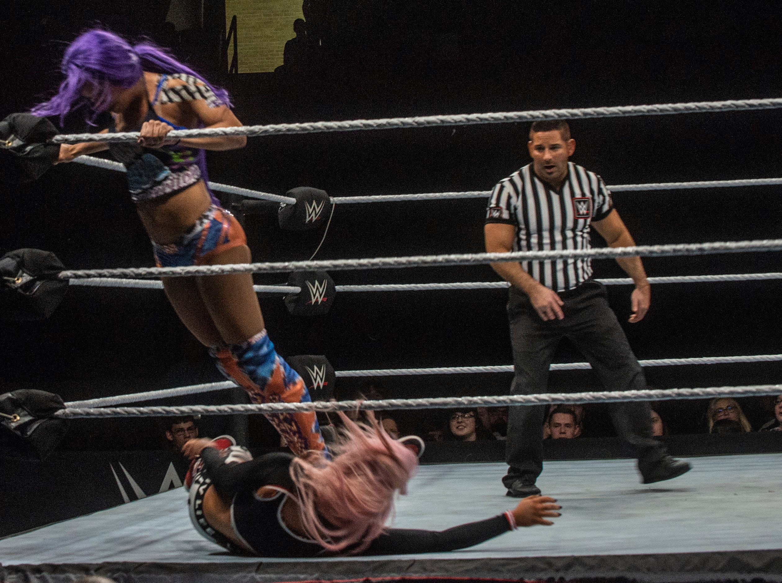 Sasha Banks delivers a stomp in the corner. Sasha Banks and Bayley defend their tag team championship against the Riott Squad. WWE Live Road to Wrestlemania came to Garrett Coliseum in Montgomery on Sunday, Feb. 24, 2019.