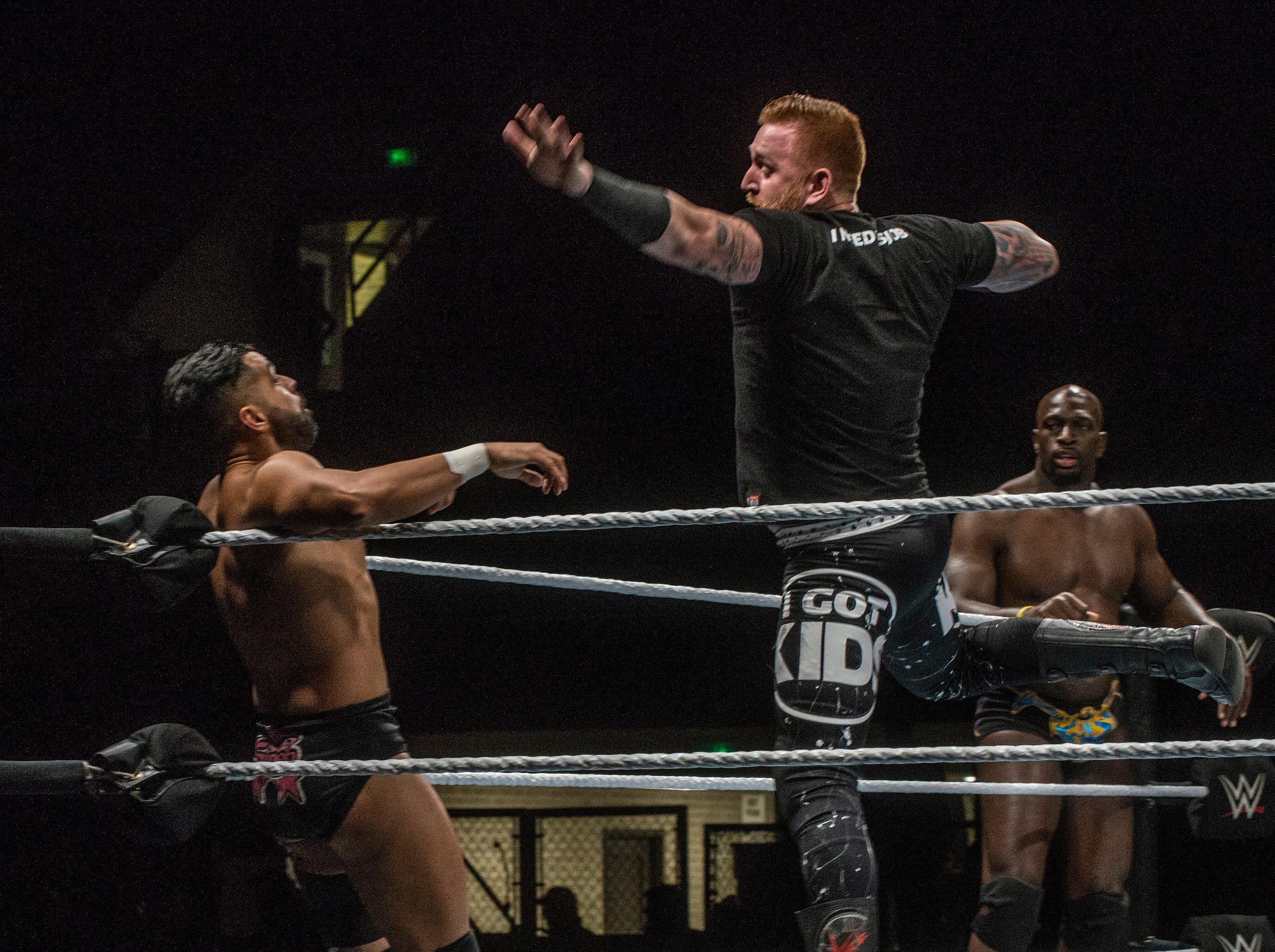 Heath Slater gives a flying shot to one of the Singh Brothers. The Singh Brothers and Jinder Mahal in a six man tag team match against Titus OÕNeil, Heath Slater and Rhyno. WWE Live Road to Wrestlemania came to Garrett Coliseum in Montgomery on Sunday, Feb. 24, 2019.