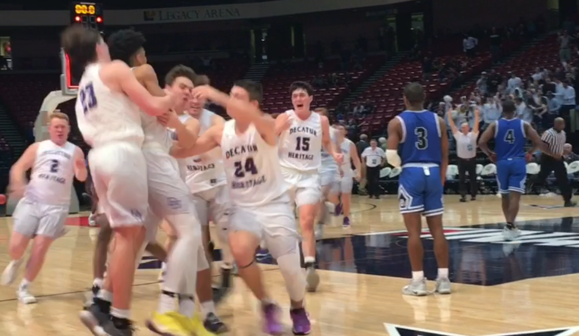 Decatur Heritage celebrates its buzzer-beating overtime victory over Georgiana in Monday's Class 1A semifinals.