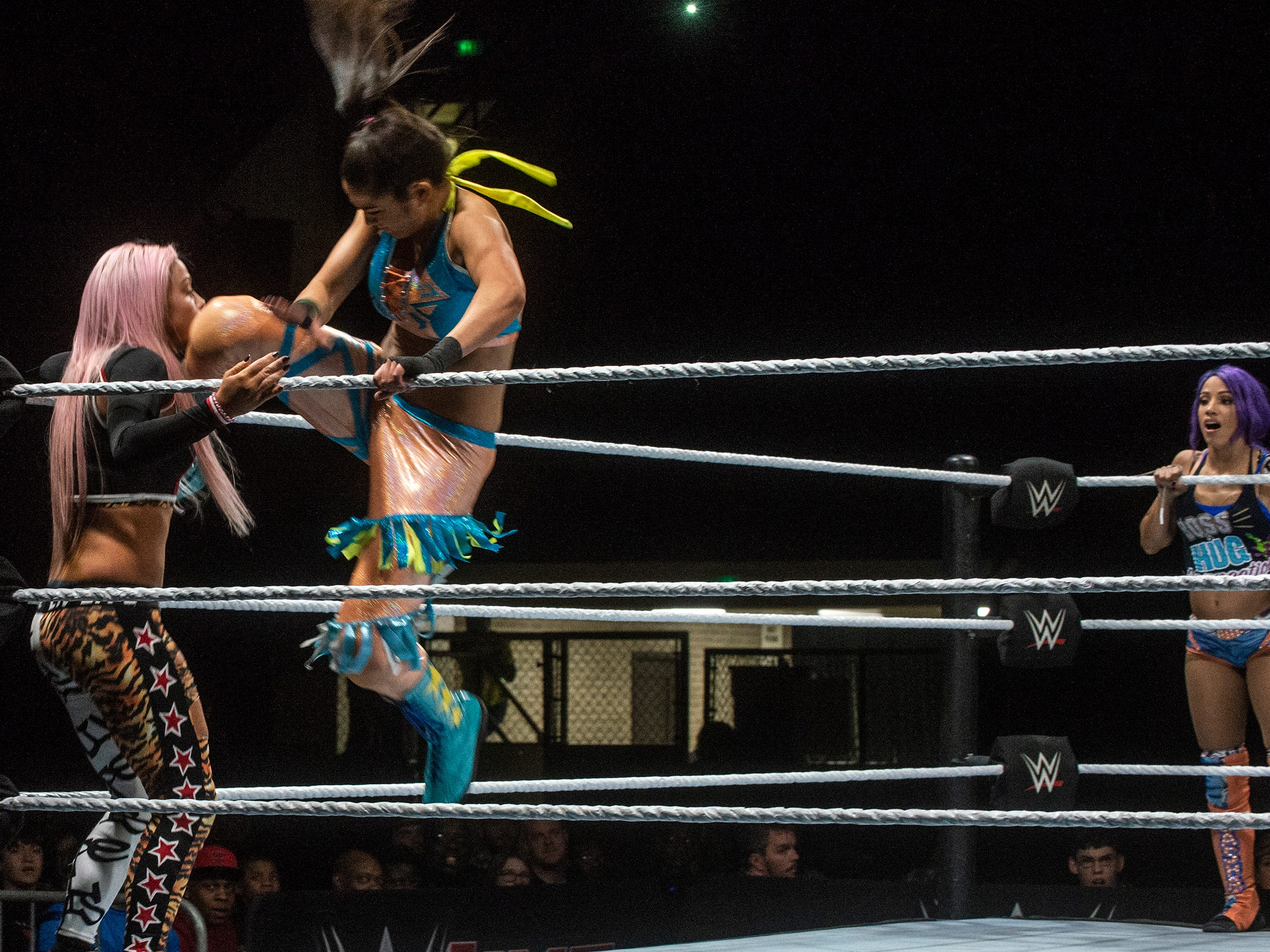 Bayley delivers a knee to the face. Sasha Banks and Bayley defend their tag team championship against the Riott Squad. WWE Live Road to Wrestlemania came to Garrett Coliseum in Montgomery on Sunday, Feb. 24, 2019.