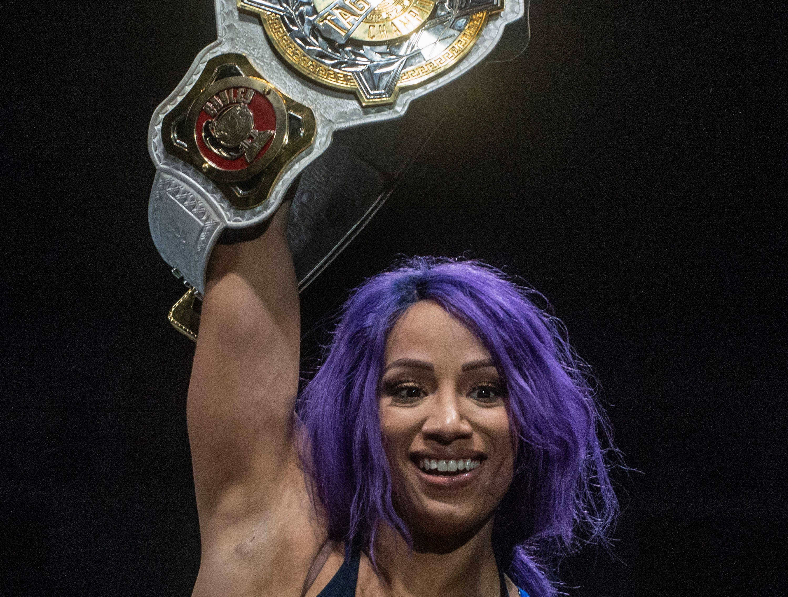 Sasha Banks raises her championship belt. Sasha Banks and Bayley defend their tag team championship against the Riott Squad. WWE Live Road to Wrestlemania came to Garrett Coliseum in Montgomery on Sunday, Feb. 24, 2019.