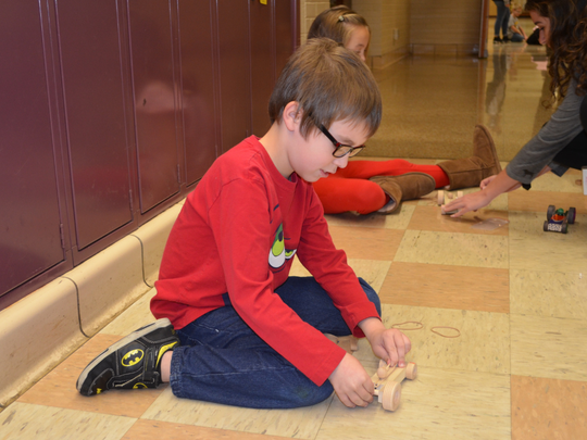 Cowan Elementary School students learn about force with rubber band racers in a past project funded through a Robert P. Bell Education Grant.