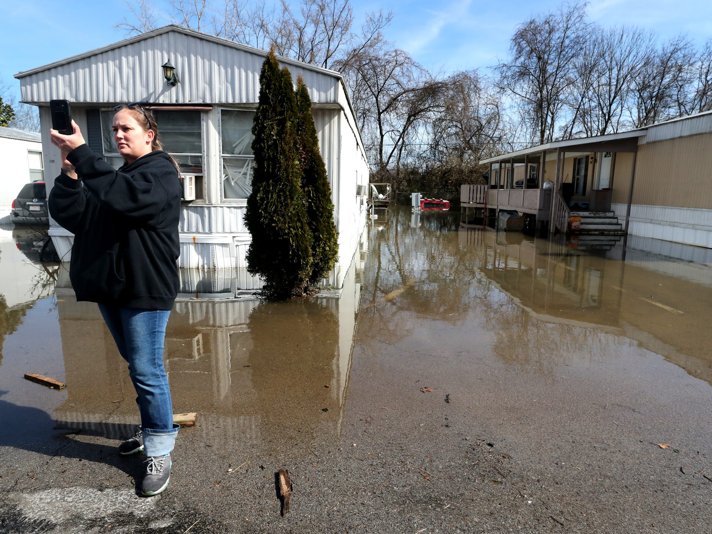 Red Cross Volunteer Wanda Audrey Ford, with the Disaster Action Team, record and document damage to homes in the Maple Manor Community Mobile Home Park, in Smyrna, Tenn., on Monday, Feb. 25, 2019.