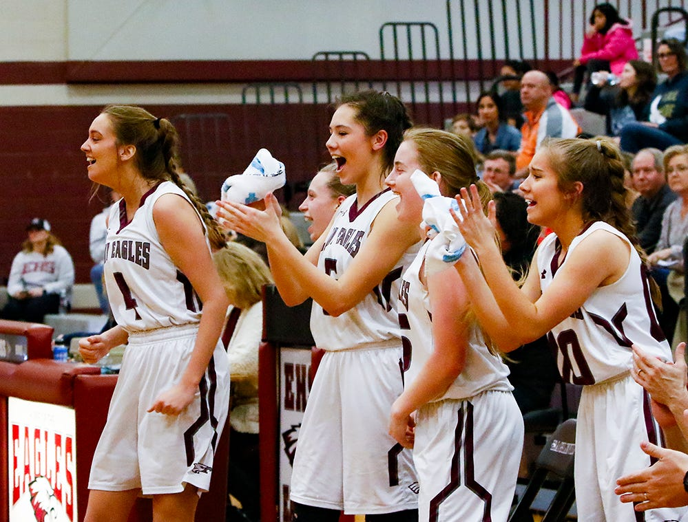 Eagleville players celebrate during the Lady Eagles' 65-18 win over Merrol Hyde Magnet in the Region 4-A quarterfinals Sunday.