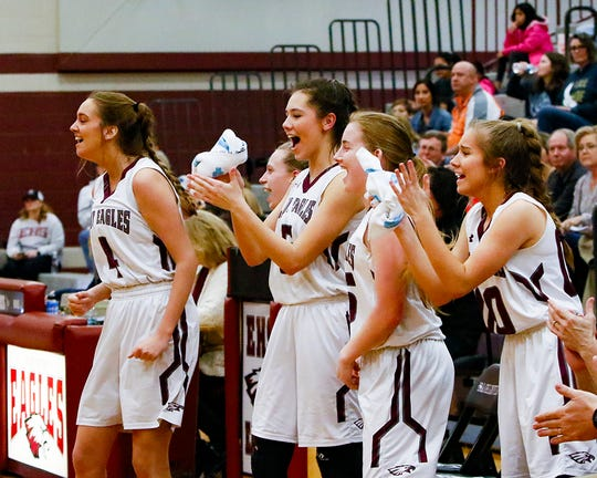 Eagleville players celebrate a recent region victory. The Lady Eagles earned a sectional berth with Monday's 53-42 win over Cascade in the Region 4-A semifinals.