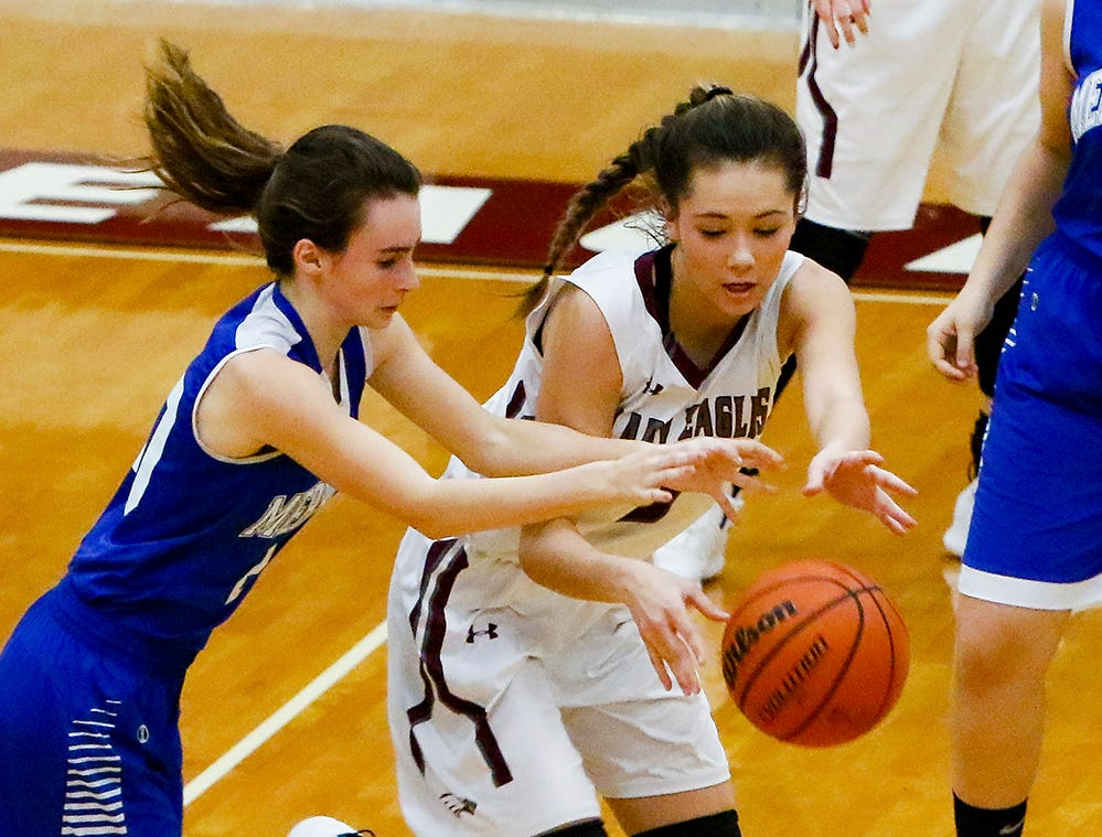 Eagleville's Lizzy Thompson battles for a loose ball with Merrol Hyde's Grace Riley during the Lady Eagles' 65-18 win over Merrol Hyde Magnet in the Region 4-A quarterfinals Sunday.