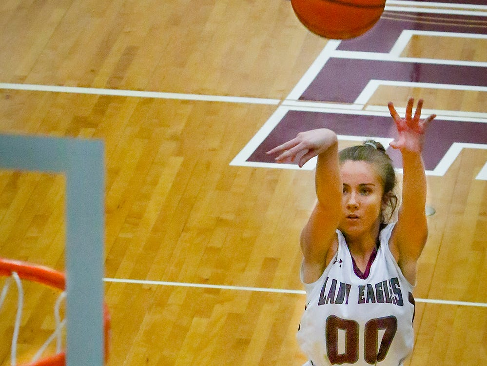 Eagleville's Haylee Ferguson fires a shot during the Lady Eagles' 65-18 win over Merrol Hyde Magnet in the Region 4-A quarterfinals Sunday.