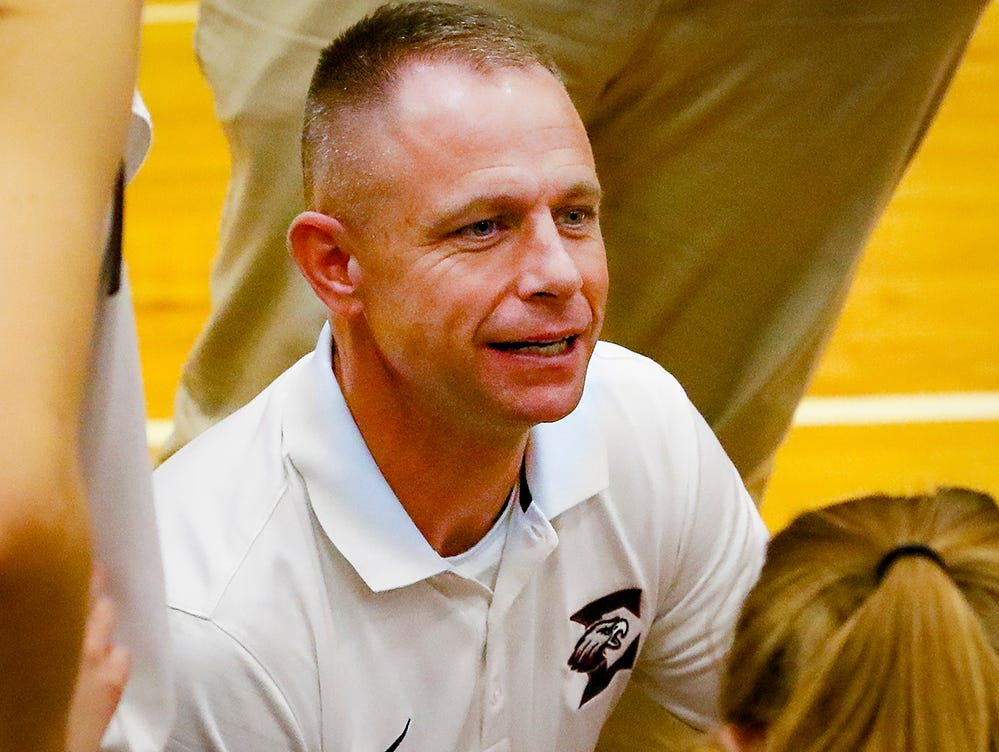 Eagleville girls coach Chris Lynch talks to players during the Lady Eagles' 65-18 win over Merrol Hyde Magnet in the Region 4-A quarterfinals Sunday.