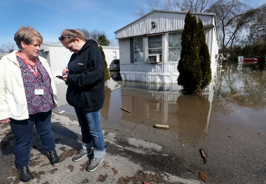 Red Cross Volunteers Wanda Durham, left and Audrey Ford, right with the Disaster Action Team record and document damage to homes in the Maple Manor Community Mobile Home Park, in Smyrna, Tenn., on Monday, Feb. 25, 2019.