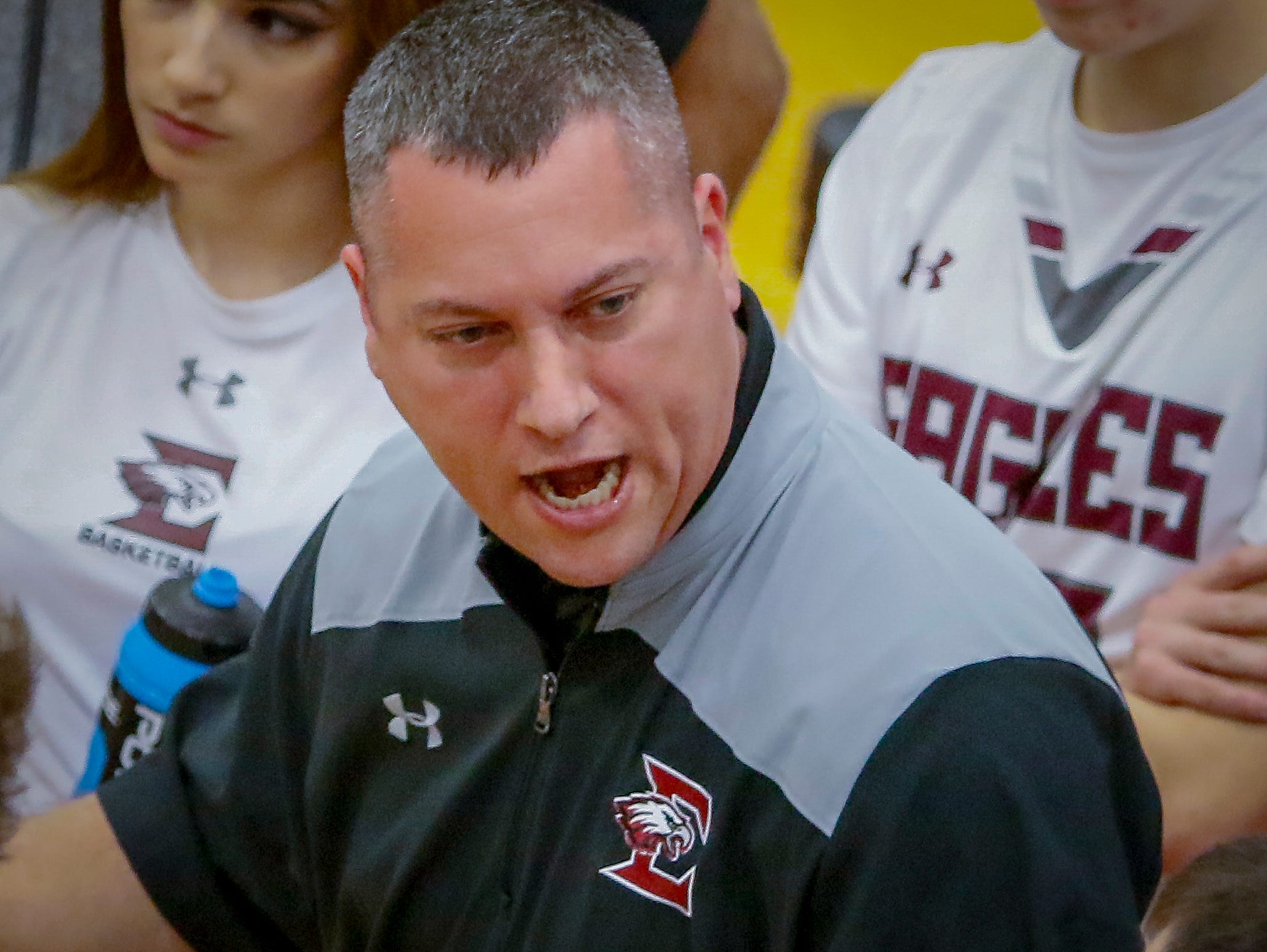 Eagleville boys coach Davy McClaran talks to his squad during the Eagles' 75-57 win over RePublic Sunday in the Region 4-A quarterfinals.