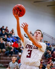 Eagleville's Ryley McClaran goes in for a layup during the Eagles' 75-57 win over RePublic Sunday in the Region 4-A quarterfinals.