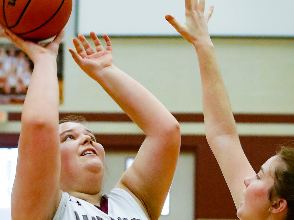 Eagleville's Maddy Richter fires a shot during the Lady Eagles' 65-18 win over Merrol Hyde Magnet in the Region 4-A quarterfinals Sunday.