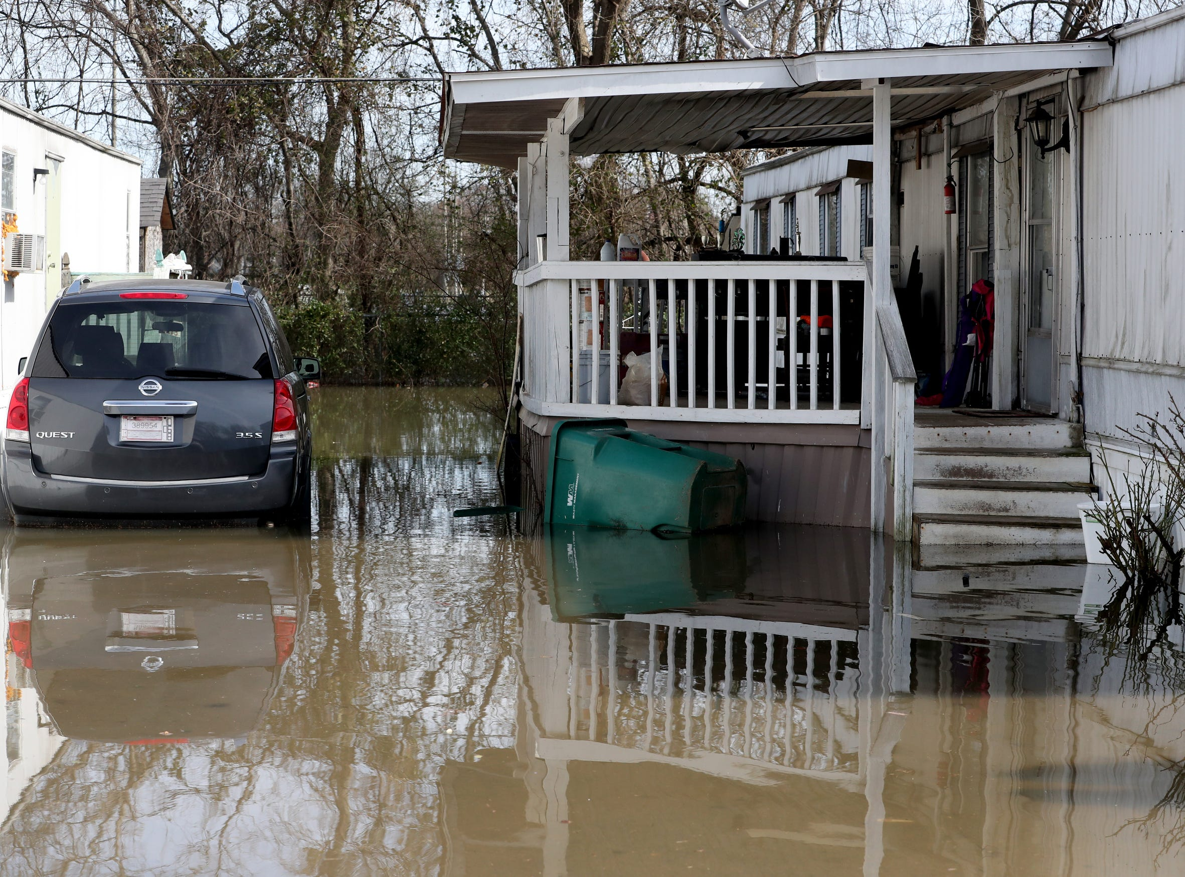 Flood waters remain high on on Monday, Feb. 25, 2019, after a nearby creek flooded many homes, over the weekend in the Maple Manor Community Mobile Home Park, on Monday, Feb. 25, 2019.