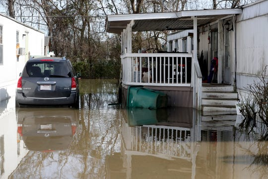 Flood waters remain high on Monday, Feb. 25, 2019, after a nearby creek flooded many homes, over the weekend in the Maple Manor Community Mobile Home Park, on Monday, Feb. 25, 2019.