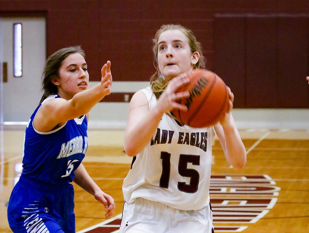 Eagleville's Makayla Moates drives to the basket as Merrol Hyde's Caroline Riley defends during the Lady Eagles' 65-18 win over Merrol Hyde Magnet in the Region 4-A quarterfinals Sunday.