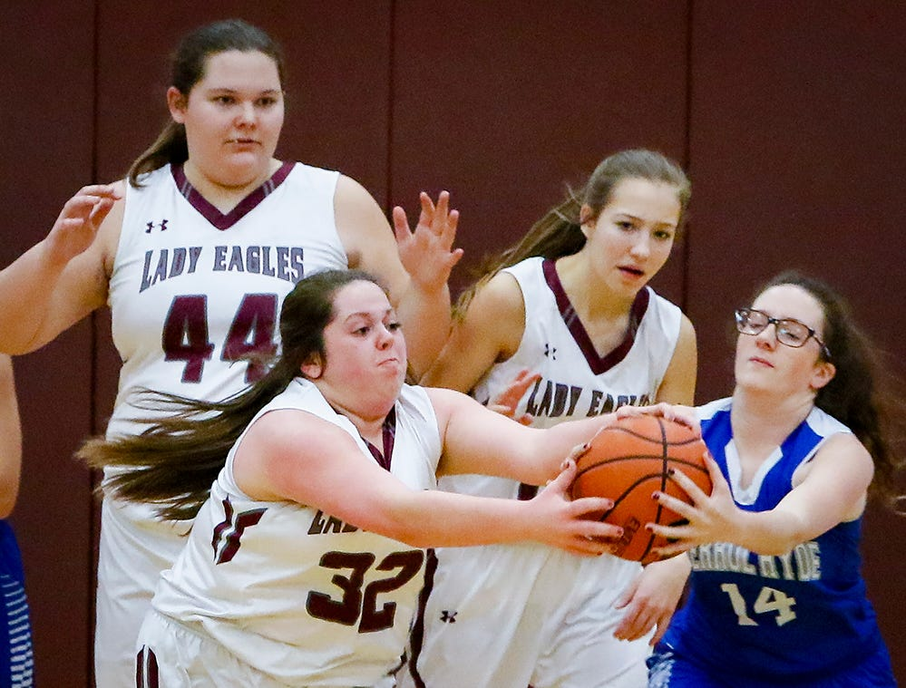 Eagleville's Summer Cooper (24) and Merrol Hyde's Natalie Betterton get tied up during the Lady Eagles' 65-18 win over Merrol Hyde Magnet in the Region 4-A quarterfinals Sunday.