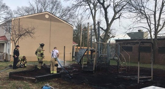 Members of the Murfreesboro Fire Rescue Department put out the fire at the playground at the Parkside housing complex in Murfreesboro, Tenn. on Monday, Feb. 25, 2019.