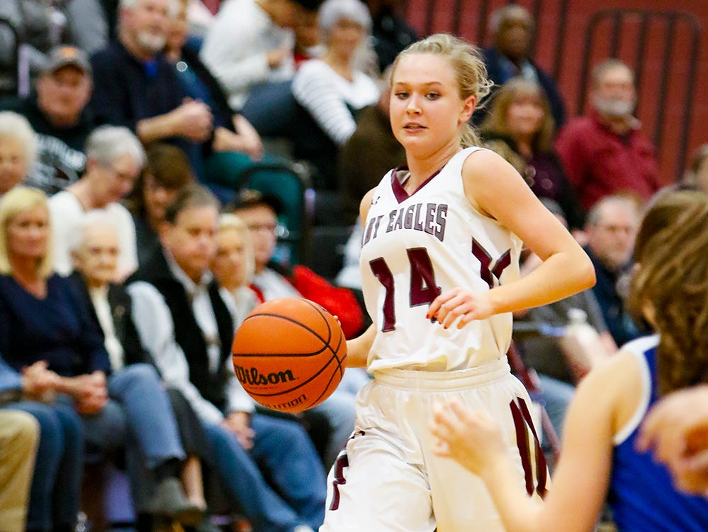Eagleville's Mary Elise Lynch takes the ball down the court during the Lady Eagles' 65-18 win over Merrol Hyde Magnet in the Region 4-A quarterfinals Sunday.