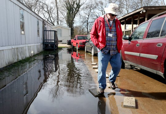 Red Cross volunteer James Hopkins tries to talk with residents as the group records and documents damage to the homes in the Maple Manor Community Mobile Home Park, in Smyrna, Tenn., on Monday, Feb. 25, 2019.