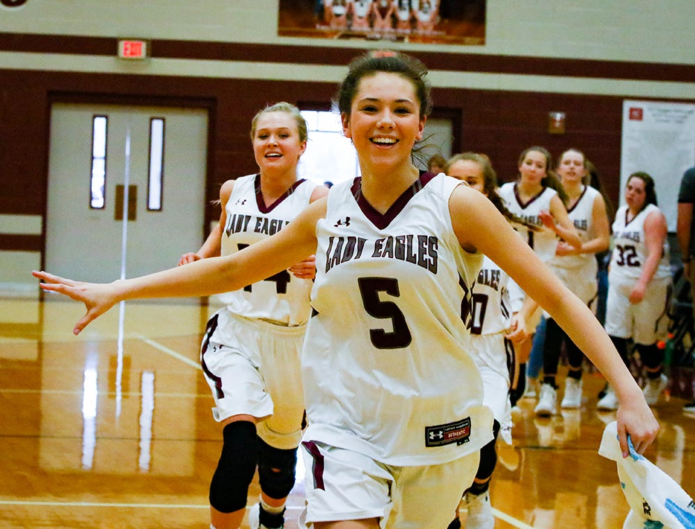 Eagleville's Lizzy Thompson leads the Lady Eagles in celebration following the Lady Eagles' 65-18 win over Merrol Hyde Magnet in the Region 4-A quarterfinals Sunday.