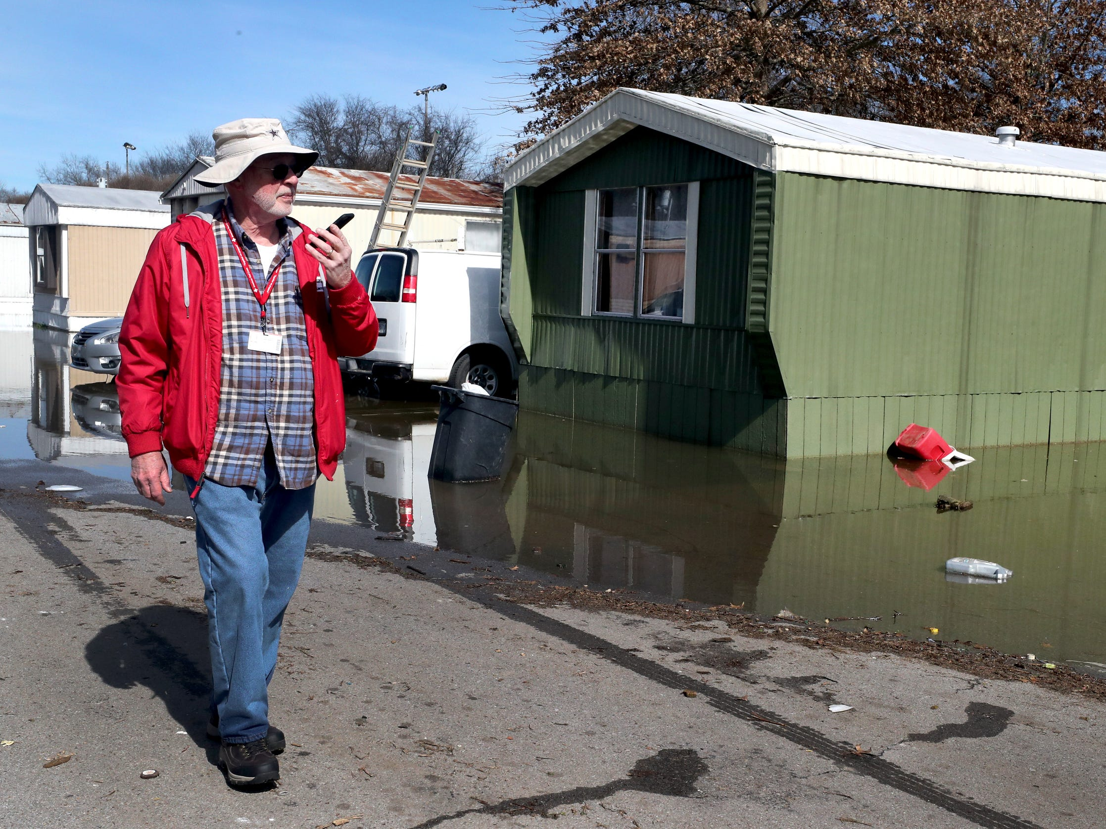 Red Cross Volunteer James Hopkins, with the Disaster Action Team records and documents damage to mobile homes in the the Maple Manor Community Mobile Home Park, in Smyrna, Tenn., on Monday, Feb. 25, 2019.