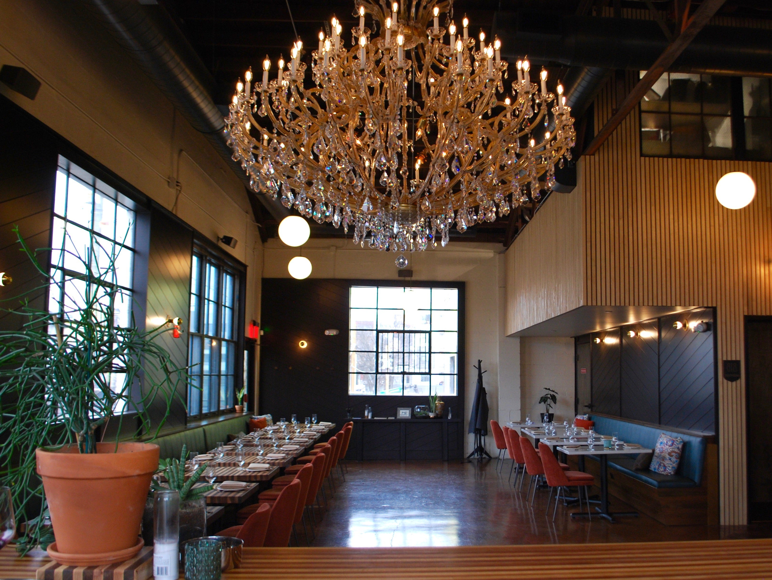 View of the dining room from the bar, including the family heirloom chandelier.