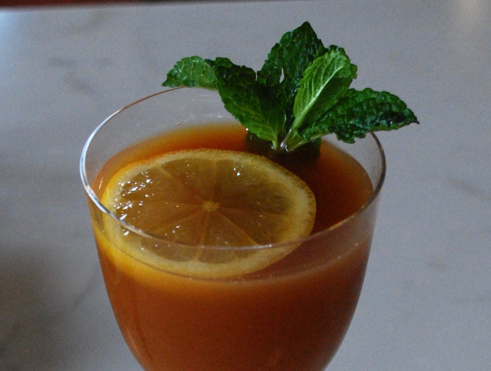 Tailor's Tea Punch is a blend of orange, pineapple and lemon juices, chai and sweet teas and fresh mint. It also can be spiked with bourbon.