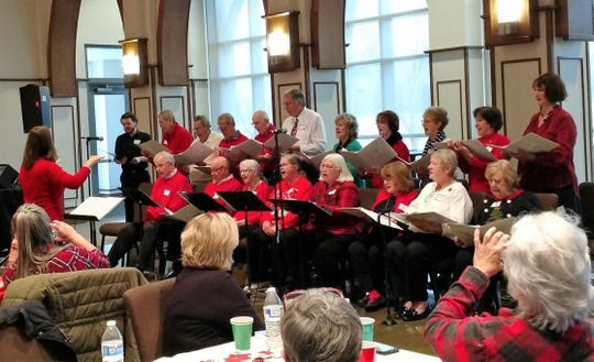 The Peterson Choir performs during a holiday luncheon.
