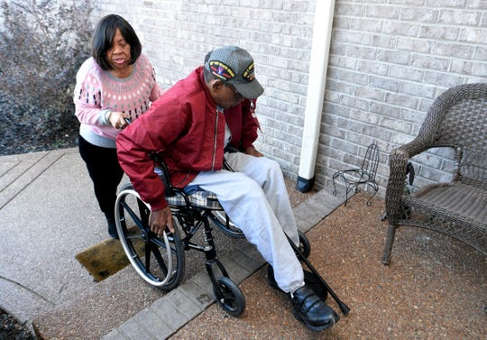 Selross Adams shows how she helps her husband, William, maneuver his wheelchair out of their Hermitage home on Feb. 25, 2019. William Adams is an amputee who was denied the right to install ramps at his new home by his HOA. He's a Vietnam War veteran who was exposed to Agent Orange and believes that caused his diabetes.