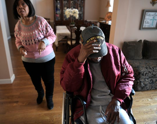 """William Adams sits in his wheelchair inside his Hermitage home while his wife, Selross, gets ready to take him to the doctor. Meadows of Seven Points homeowners' association members demanded the couple remove wheelchair ramps from their home, citing aesthetic guidelines. """"This is not something you want to do because you want to look fancy,"""" Selross said of the ramps. """"This is a necessity."""""""