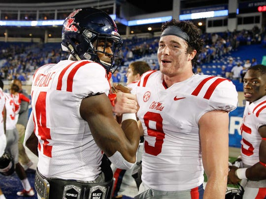Ole Miss Rebels wide receiver D.K. Metcalf (14) celebrates with tight end Dawson Knox (9) after the game against the Kentucky Wildcats at Commonwealth Stadium Nov. 4, 2017. Ole Miss defeated Kentucky 37-34.