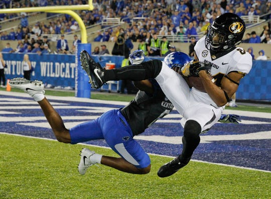 Missouri Tigers wide receiver Emanuel Hall (84) catches a pass against Kentucky Wildcats cornerback Derrick Baity (8) in the second half at Commonwealth Stadium. Kentucky defeated Missouri 40-34 Oct. 7, 2017..
