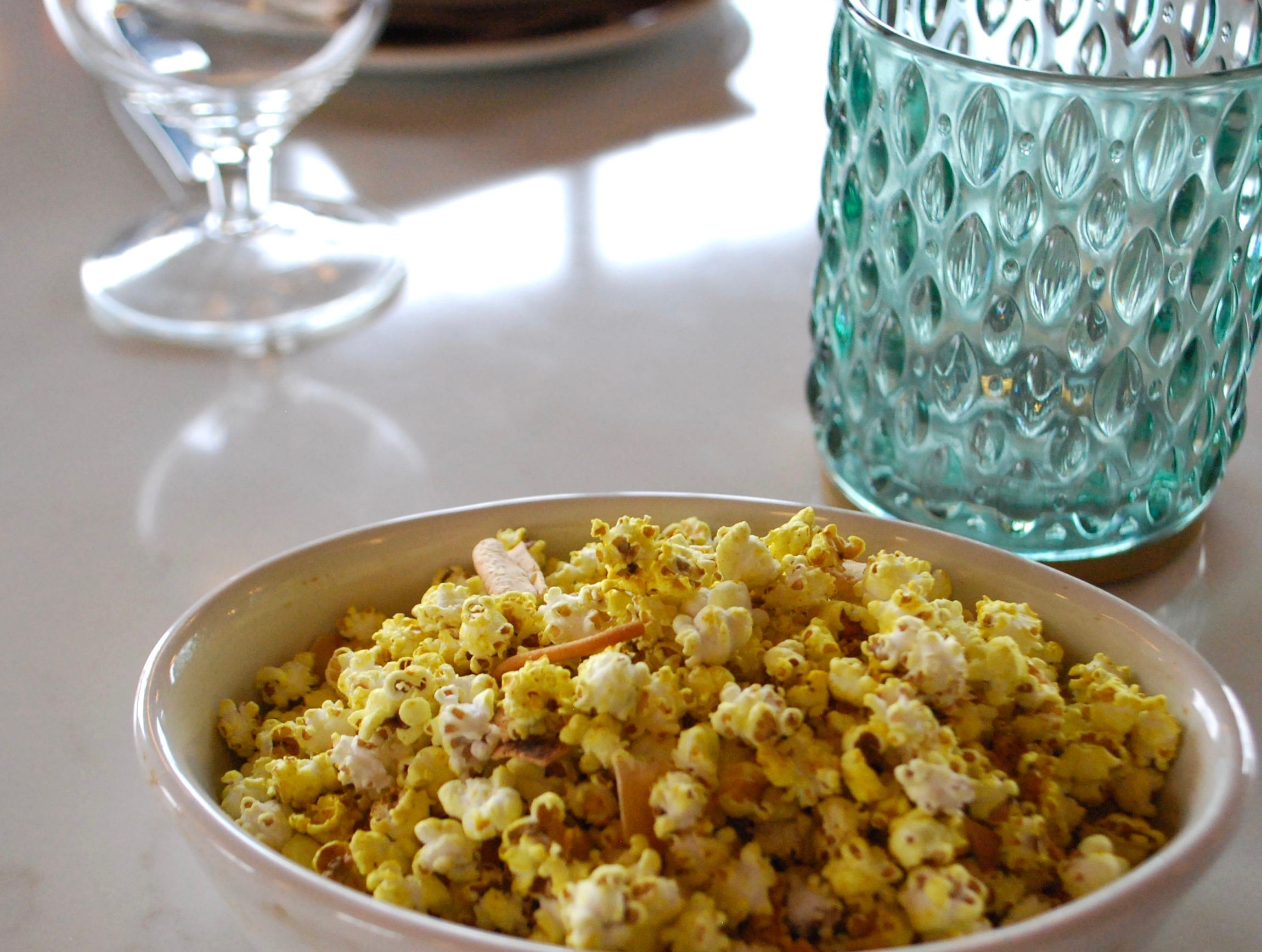Spiced sorghum popcorn, pappadum and sev mixture.