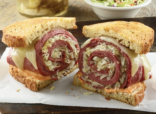 TooJay's Reuben and other deli sandwiches feature hand-sliced meats that are rolled up with the other ingredients.