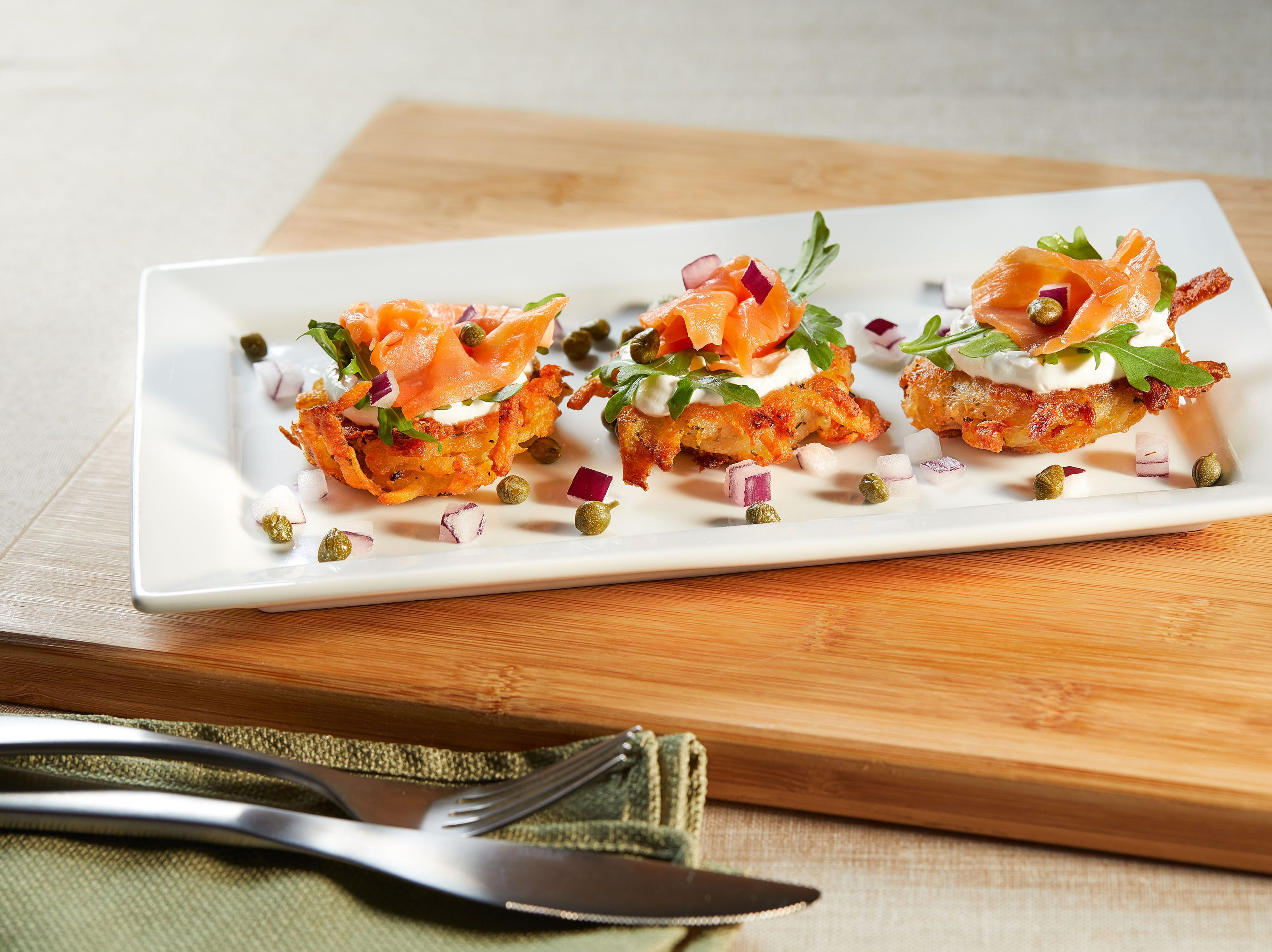 Nova latkes at TooJay's Deli are crispy miniature potato pancakes topped with sliced smoked salmon and sour cream.