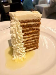 A 10-layer carrot cake at Ocean Prime is stacked on top of creamy pineapple syrup.