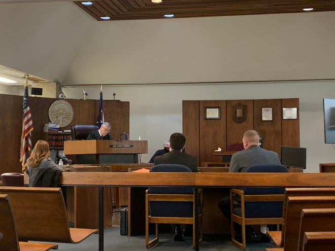 Jonathan Yaeger (right) sits beside his attorney during a change of plea and sentencing hearing in Licking County Municipal Court on Monday, Feb. 25, 2019.