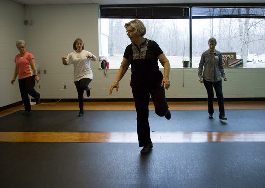 Donna Stasel (front row) teaches a beginner tap class to participants Sally Still, Marilyn Krebs and Marianne Griffe on Friday mornings at the Granville Senior Center.