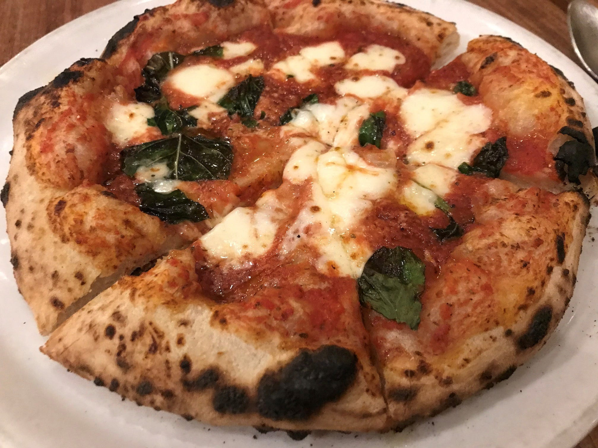 The margherita pizza at Aqulia Pizza Al Forno has a perfectly charred crust.
