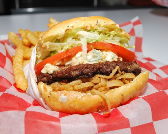 The A-1 Blue Burger, with lettuce, tomato, blue cheese crumbles, A-1 Steak Sauce and onion straws on a Miami onion bun, at 25 Burgers in Bound Brook.